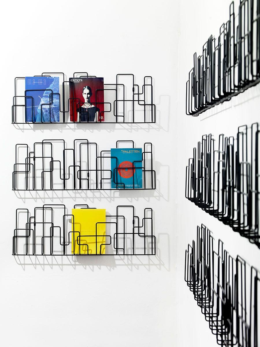 CitySunday tidningsställ vägg