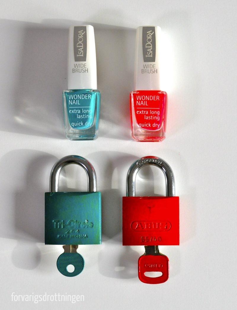 hänglås och nyckel målade med nagellack